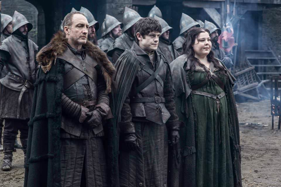 Michael McElhatton as Roose Bolton, Iwan Rheon as Ramsay Bolton and Elizabeth Webster as Walda Frey – photo Helen Sloan/HBO