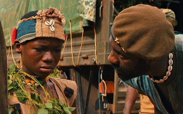 Idris Elba y Abraham Attah en 'Beasts of No Nation', primera cinta original de Netflix. © 2015 - Netflix