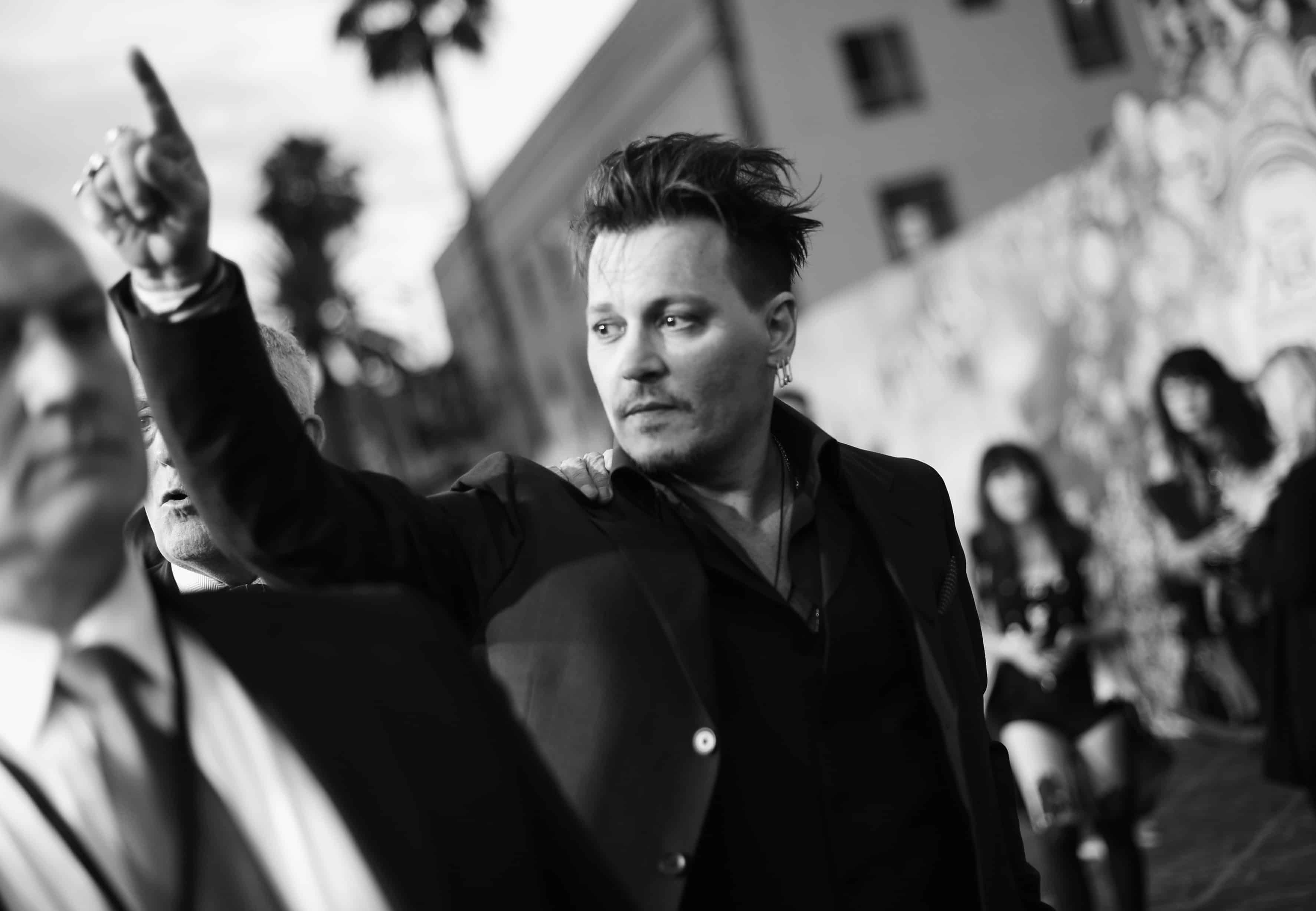 HOLLYWOOD, CA - MAY 23: (EDITORS NOTE: Image has been shot in black and white. Color version not available.) Actor Johnny Depp attends Disney's 'Alice Through the Looking Glass' premiere with the cast of the film, which included Johnny Depp, Anne Hathaway, Mia Wasikowska and Sacha Baron Cohen at the El Capitan Theatre on May 23, 2016 in Hollywood, California. (Photo by Charley Gallay/Getty Images for Disney) *** Local Caption *** Johnny Depp