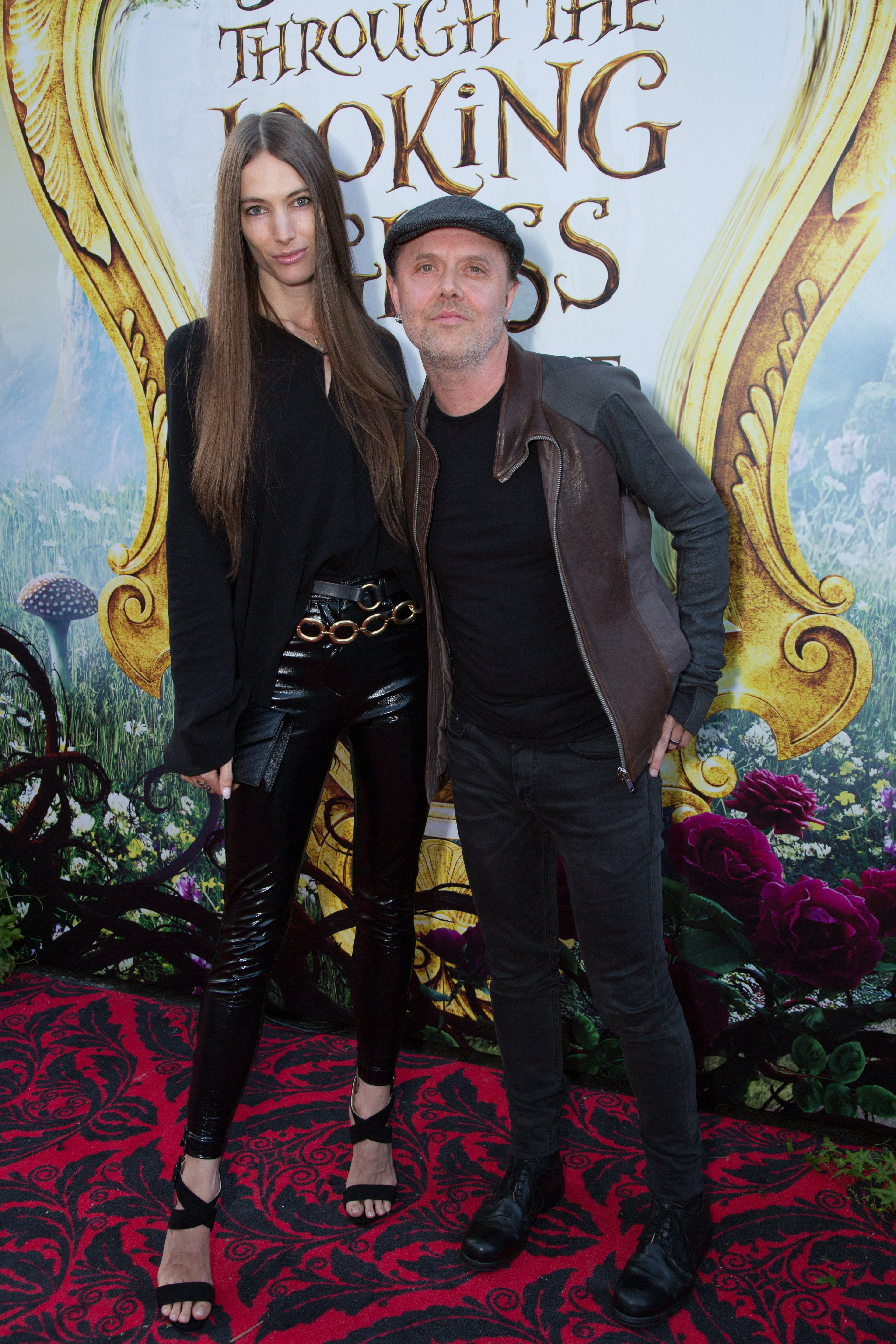 "Jessica Miller and Lars Ulrich arrive at The US Premiere of Disney's ""Alice Through the Looking Glass"" at the El Capitan Theater in Los Angeles, CA on Monday, May 23, 2016. (Photo: Alex J. Berliner/ABImages)"