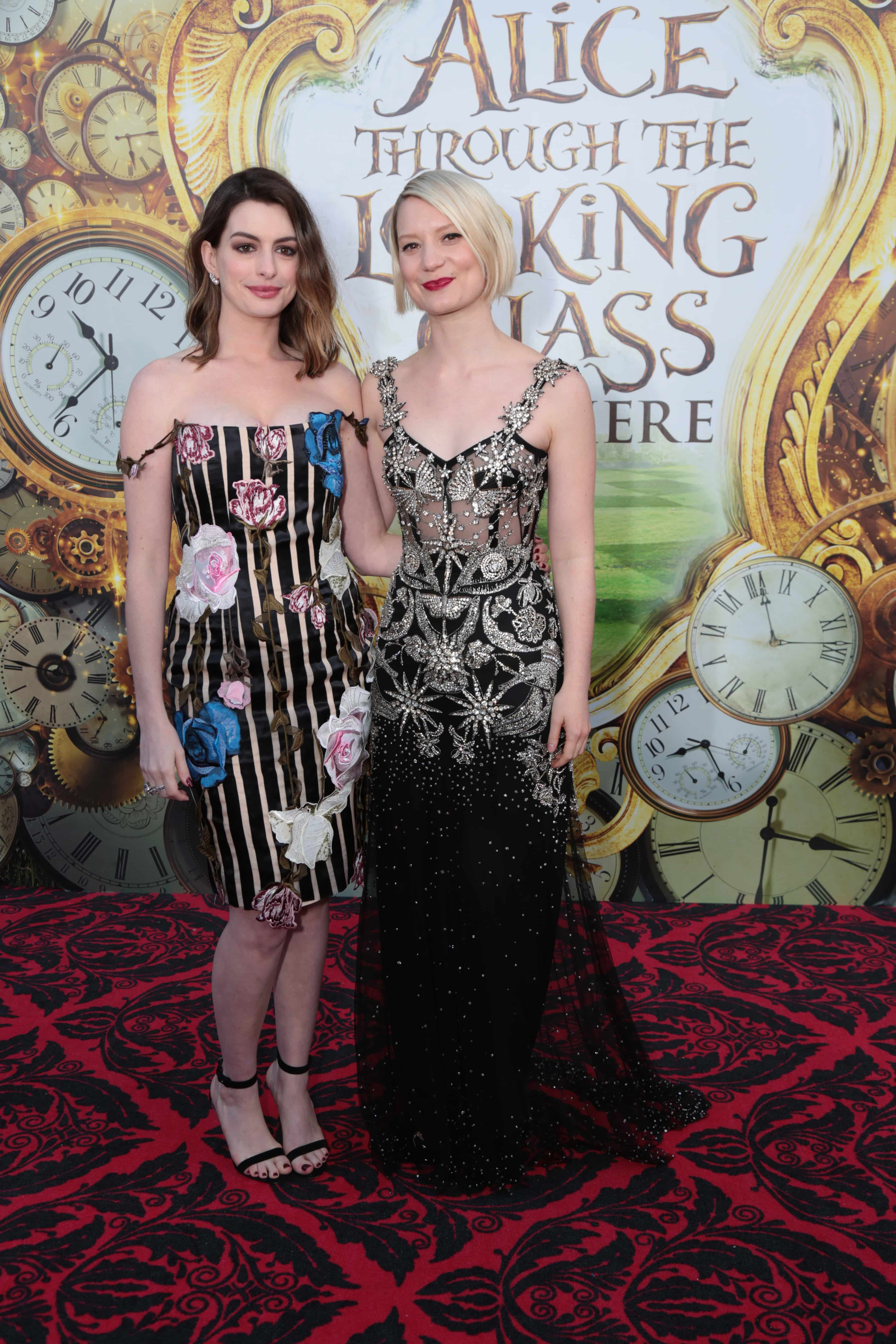 "Anne Hathaway and Mia Wasikowska pose together at The US Premiere of Disney's ""Alice Through the Looking Glass"" at the El Capitan Theater in Los Angeles, CA on Monday, May 23, 2016. (Photo: Alex J. Berliner/ABImages)"