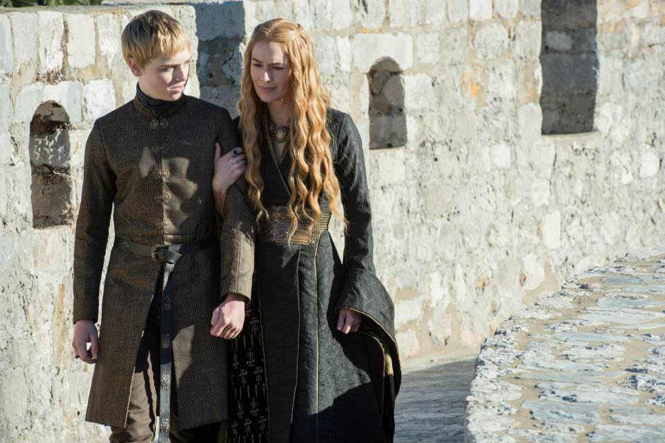 Dean-Charles Chapman as Tommen Baratheon and Lena Headey as Cersei Lannister – photo Macall B. Polay/HBO