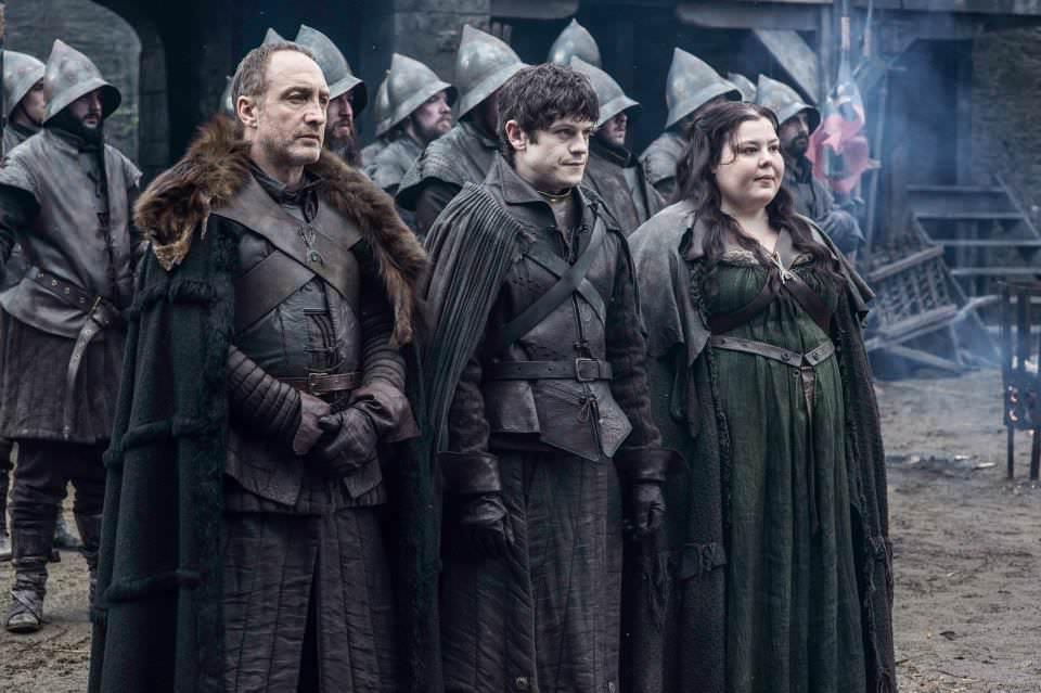 Michael McElhatton as Roose Bolton, Iwan Rheon as Ramsay Bolton and Elizabeth Webster as Walda Frey – photo Helen Sloan/HBO