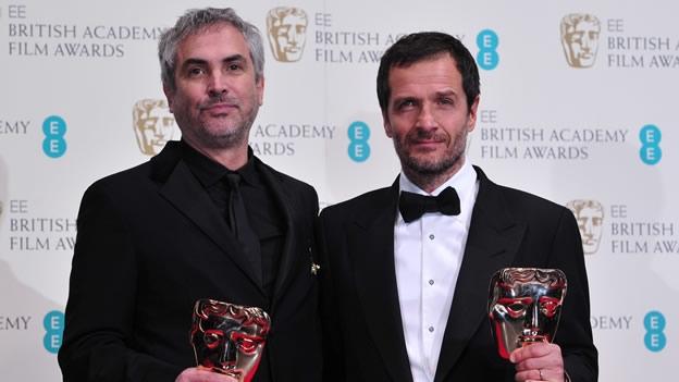 Alfonso Cuaron y David Heyman en los BAFTA ganadores por Gravity