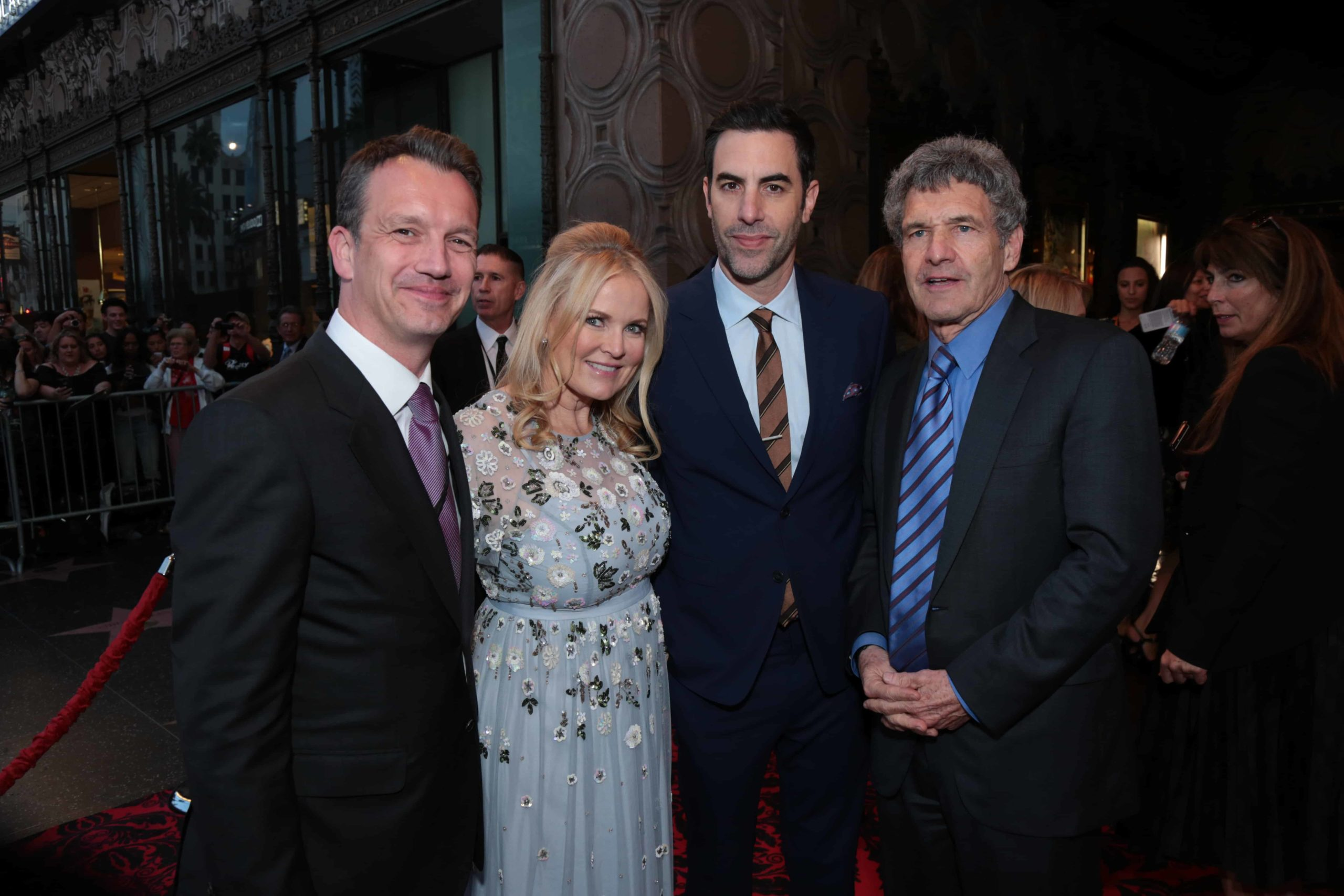 """Shawn Bailey, Suzanne Todd, Sacha Baron Cohen, Alan Horn pose together at The US Premiere of Disney's """"Alice Through the Looking Glass"""" at the El Capitan Theater in Los Angeles, CA on Monday, May 23, 2016. (Photo: Alex J. Berliner/ABImages)"""
