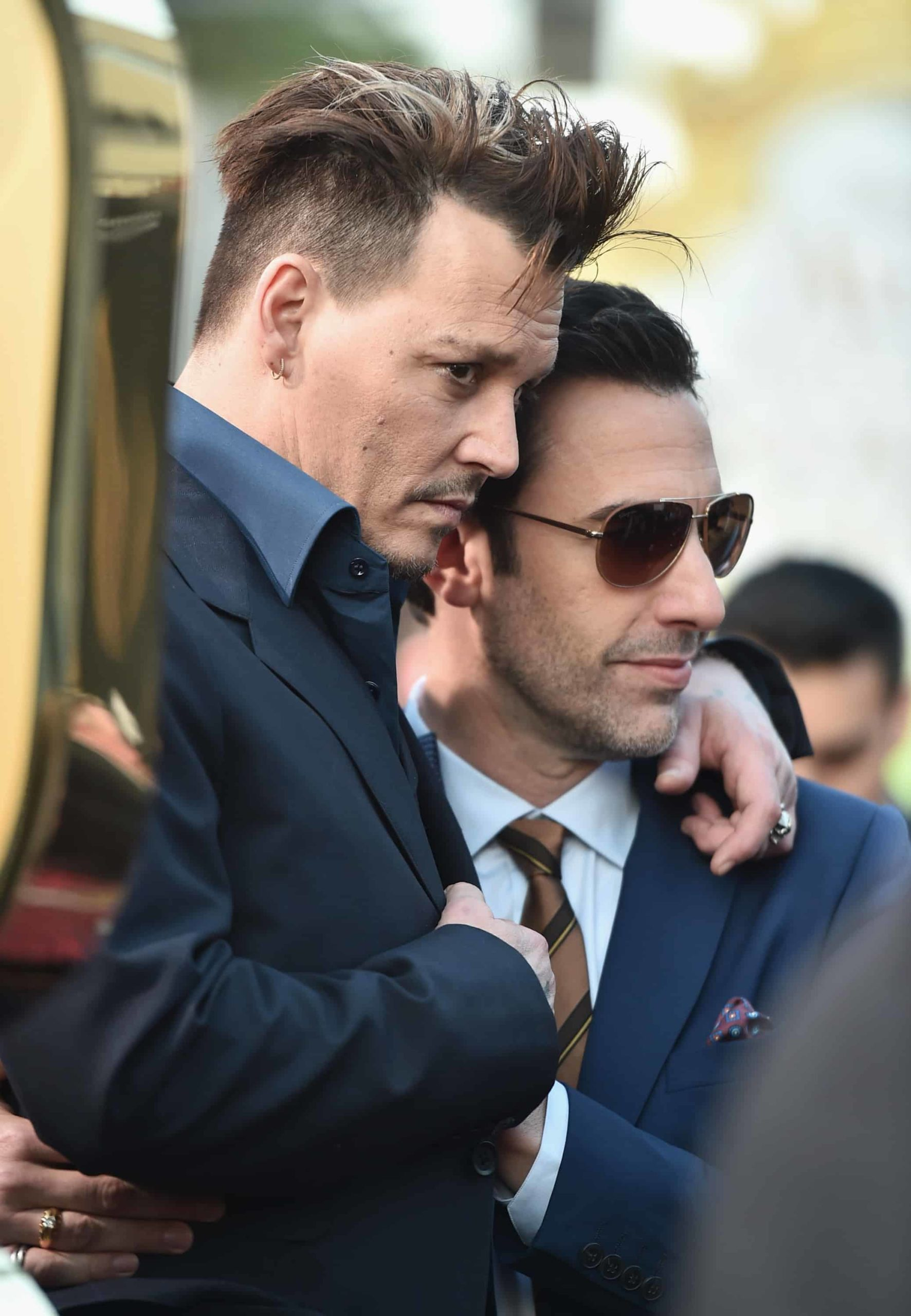 HOLLYWOOD, CA - MAY 23: Actors Johnny Depp and Sacha Baron Cohen attend Disney's 'Alice Through the Looking Glass' premiere with the cast of the film, which included Johnny Depp, Anne Hathaway, Mia Wasikowska and Sacha Baron Cohen at the El Capitan Theatre on May 23, 2016 in Hollywood, California. (Photo by Alberto E. Rodriguez/Getty Images for Disney) *** Local Caption *** Johnny Depp; Sacha Baron Cohen