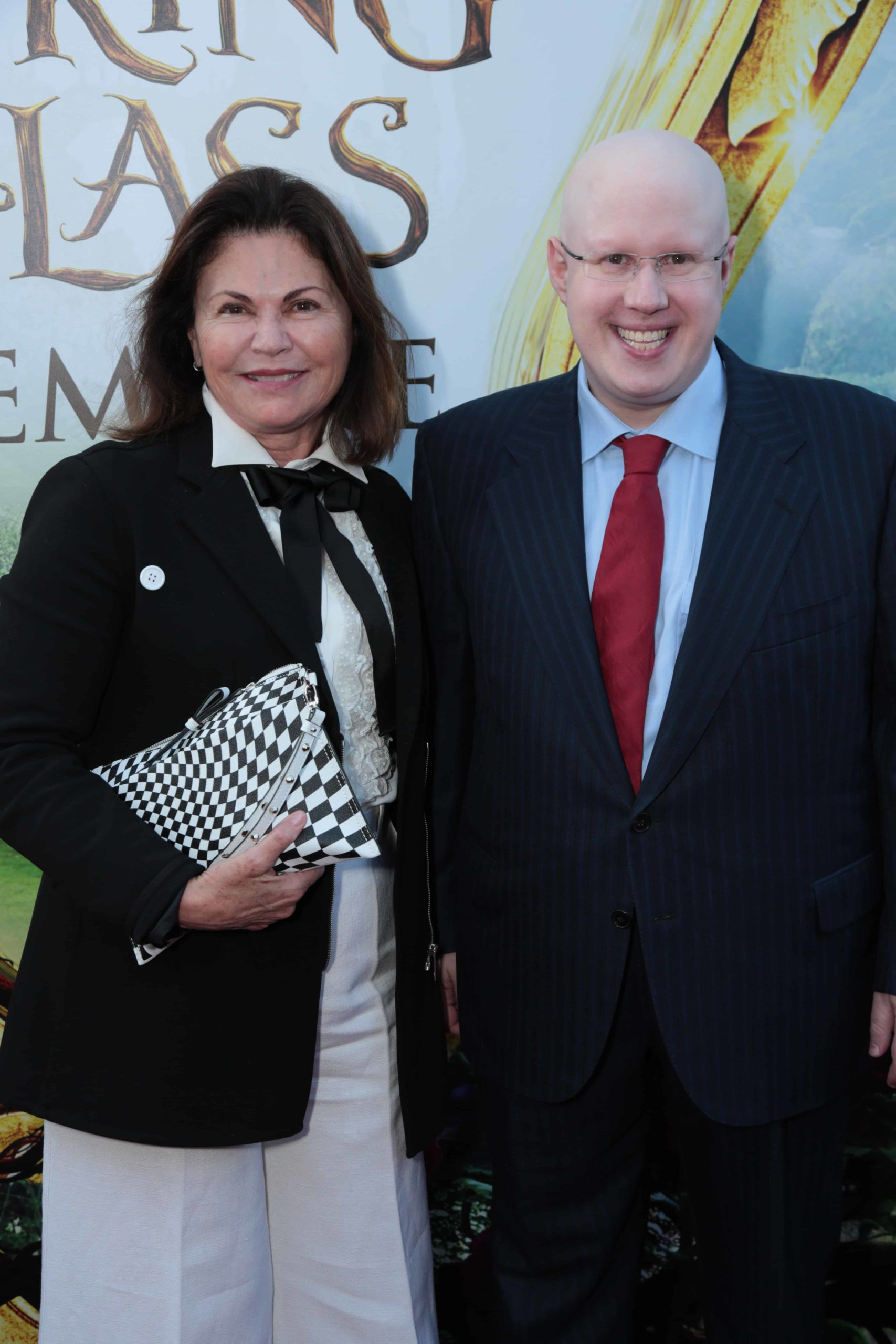 """Colleen Atwood and Matt Lucas pose together at The US Premiere of Disney's """"Alice Through the Looking Glass"""" at the El Capitan Theater in Los Angeles, CA on Monday, May 23, 2016. (Photo: Alex J. Berliner/ABImages)"""