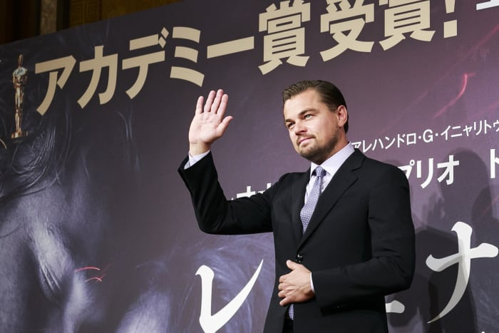 Leonardo DiCaprio poses for the cameras during a press conference for the film The Revenant at the Ritz-Carlton Hotel Tokyo