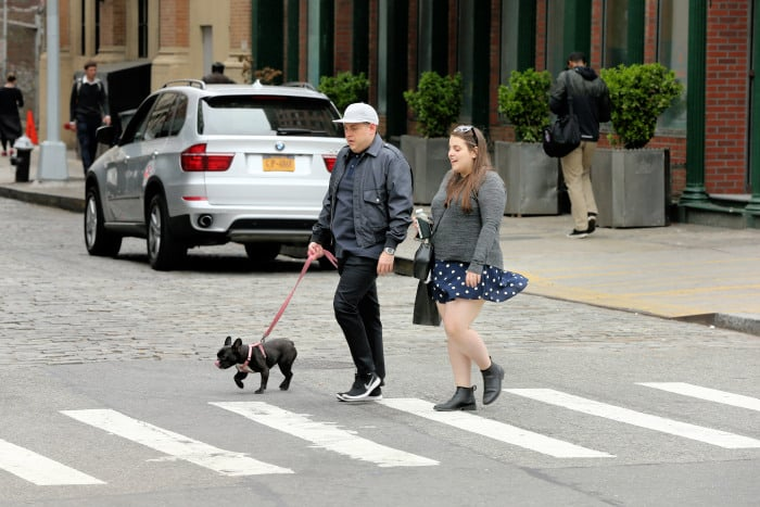Actor Jonah Hill walks his French bulldog Carmela with his sister Beanie Feldstein in New York City